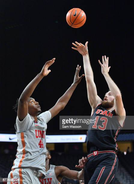 David Collette of the Utah Utes shoots against Brandon McCoy of the UNLV Rebels during the championship game of the Main Event basketball tournament...