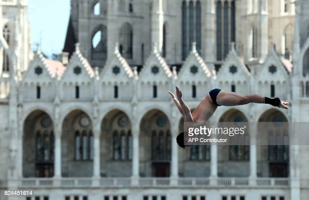 David Colturi competes in round 3 of the men's High Diving competition at the 2017 FINA World Championships in Budapest on July 30 2017 / AFP PHOTO /...