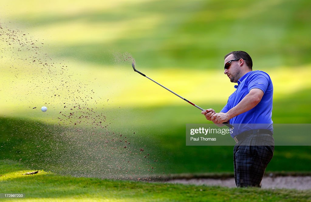 David Cooper of Newcastle Under Lyme Golf Club plays a shot on the 4th hole during the Lombard Trophy PGA National Pro-Am Championship Regional Final at Dunham Forest Golf and Country Golf Club on July 5, 2013 in Manchester, England.
