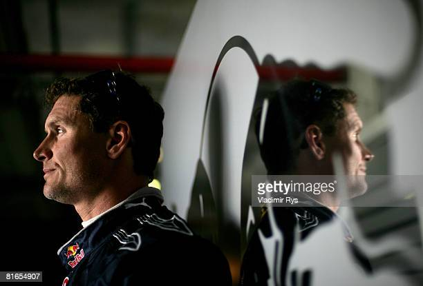 David Coulthard of Great Britain and Red Bull Racing looks on in the garage prior qualifying for the French Formula One Grand Prix at the Circuit de...