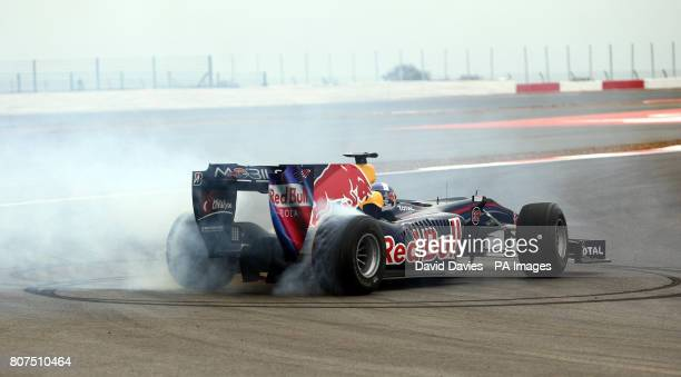 David Coulthard performs a doughnut in a Red Bull F1 Racing Car at the launch of the new Silverstone Circuit in Northamptonshire