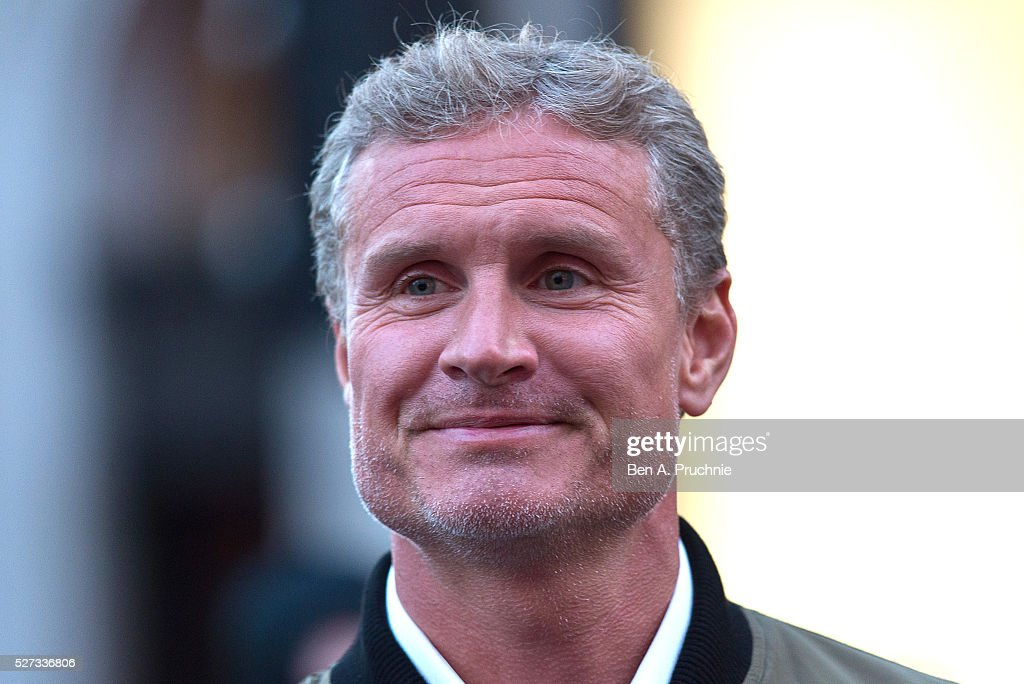 David Coulthard poses next to the 'Batmobile' as Gumball Rally closes down Regent Street at Regent Street on May 3, 2016 in London, England.