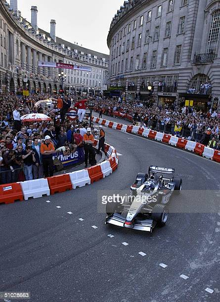 David Coulthart of McLaren takes a lap of Regent St London 06 May 2004 The busy street normally filled with shoppers was blocked off for the F1...
