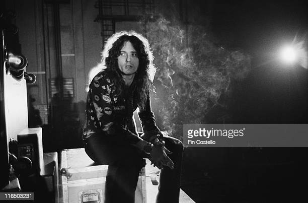 David Coverdale British singer with heavy rock band Whitesnake smoking a cigarette on the set of a video shoot at Shepperton Studios outside London...