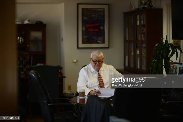 J David Cox president of the American Federation of Government Employees prepares for several congressional hearings inside his office near the US...