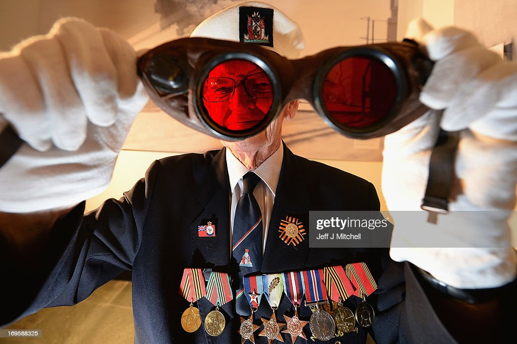 David Craig former merchant navy holds a pair of arctic goggles as he attends a preview of the Arctic Convoys exhibition at the National War Museum on May 28, 2013 in Edinburgh, Scotland. The exhibition opens at the National War Museum at Edinburgh Castle on 29th May and tells the story of the British and Allied sailors who operated one of the most dangerous sea faring campaigns of the Second World War.