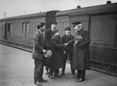 David Crichton Lamb of the Salvation Army bids farewell to a group of orphaned boys from the Dr Barnardo's Homes as they leave Waterloo Station in...