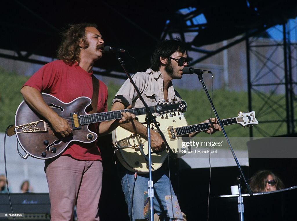 David Crosby and Neil Young of Crosby, Stills, Nash And Young perform live on stage at Oakland Stadium, California during their 1974 US Tour on July 14 1974 in Oakland, United States.