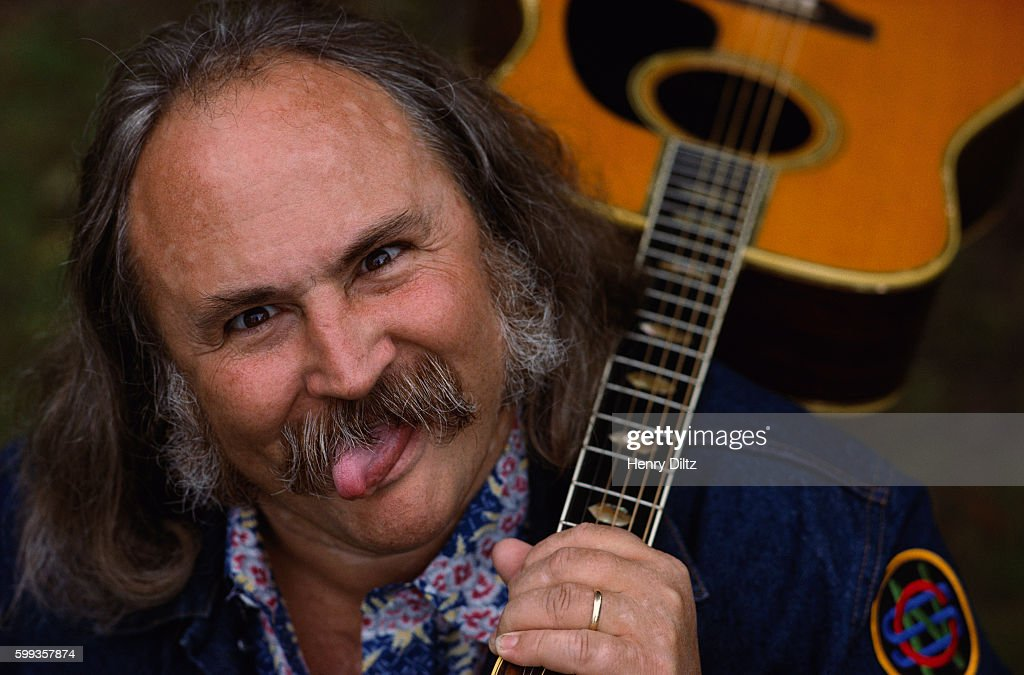 David Crosby Making Face and Holding Guitar