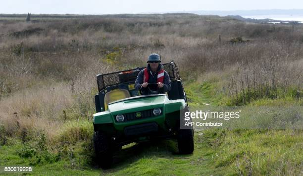 David Cuisnier drives his car on August 9 2017 in the island of Quemenes in Le Conquet western France A family rehabilated a breeding and ecological...
