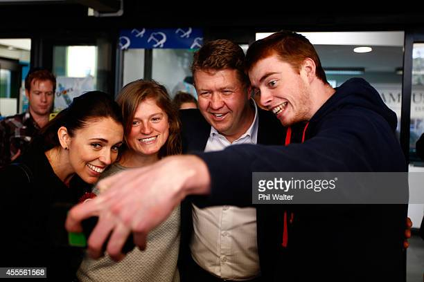 David Cunliffe Leader of the Labour Party and Auckland Centralbased MP Jacinda Ardern have their photo taken with students at Auckland University on...