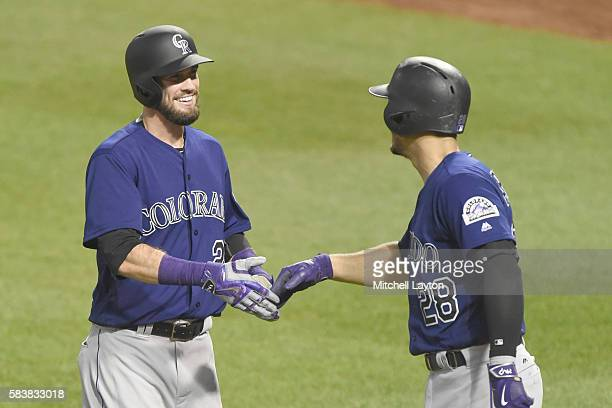 David Dahl of the Colorado Rockies celebrates a solo home run in the sixth inning with Nolan Arenado during a baseball game against the Baltimore...