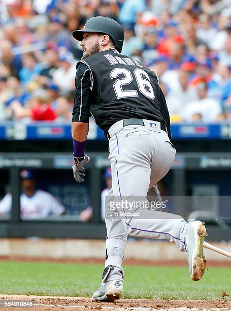 David Dahl of the Colorado Rockies follows through on a second inning double against the New York Mets at Citi Field on July 31 2016 in the Flushing...