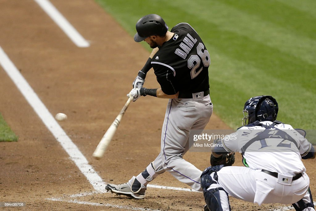David Dahl of the Colorado Rockies hits a single during the third inning against the Milwaukee Brewers at Miller Park on August 23 2016 in Milwaukee...