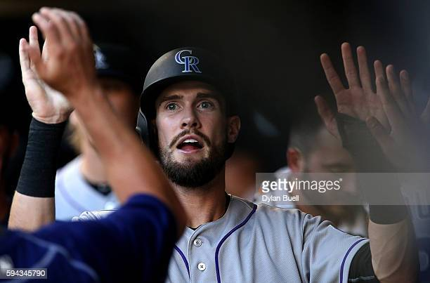 David Dahl of the Colorado Rockies is congratulated by teammates after scoring a run in the first inning against the Milwaukee Brewers at Miller Park...
