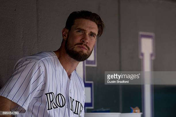 David Dahl of the Colorado Rockies looks out of the dugout during a game against the Chicago Cubs at Coors Field on August 21 2016 in Denver Colorado