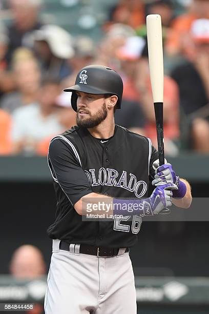 David Dahl of the Colorado Rockies prepares for a pitch during a baseball game against the Baltimore Orioles at Oriole Park at Camden Yards on July...