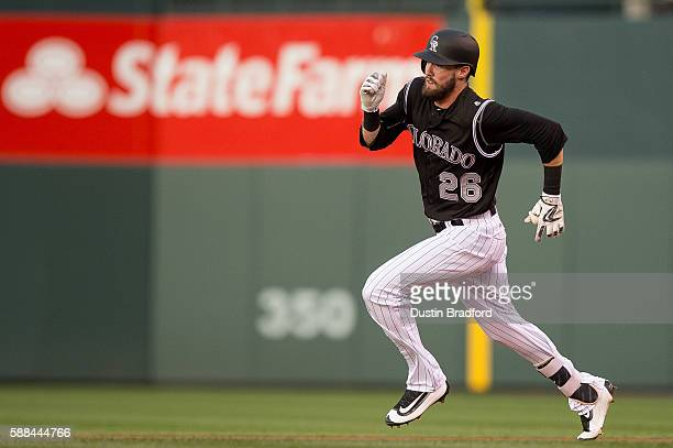 David Dahl of the Colorado Rockies runs out a leadoff triple in the second inning of a game against the Miami Marlins at Coors Field on August 6 2016...