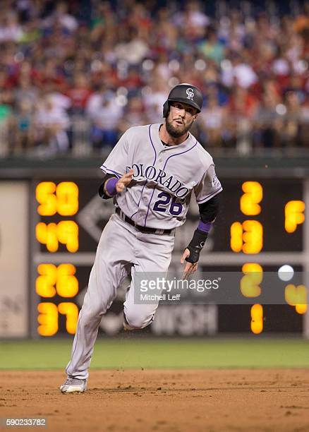David Dahl of the Colorado Rockies runs the bases against the Philadelphia Phillies at Citizens Bank Park on August 12 2016 in Philadelphia...