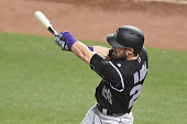 David Dahl of the Colorado Rockies singles for his first major league hit in the seventh inning during a baseball game against the Baltimore Orioles...