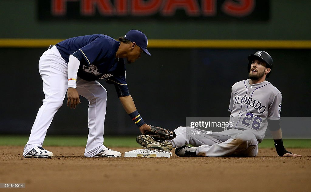 David Dahl #26 of the Colorado Rockies steals second base past Orlando Arcia #3 of the Milwaukee Brewers in the fifth inning at Miller Park on August 22, 2016 in Milwaukee, Wisconsin.
