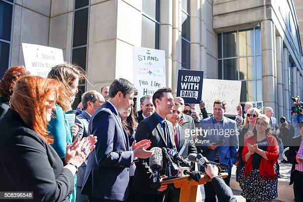 David Daleiden a defendant in an indictment stemming from a Planned Parenthood video he helped produce speaks to the media after appearing in court...