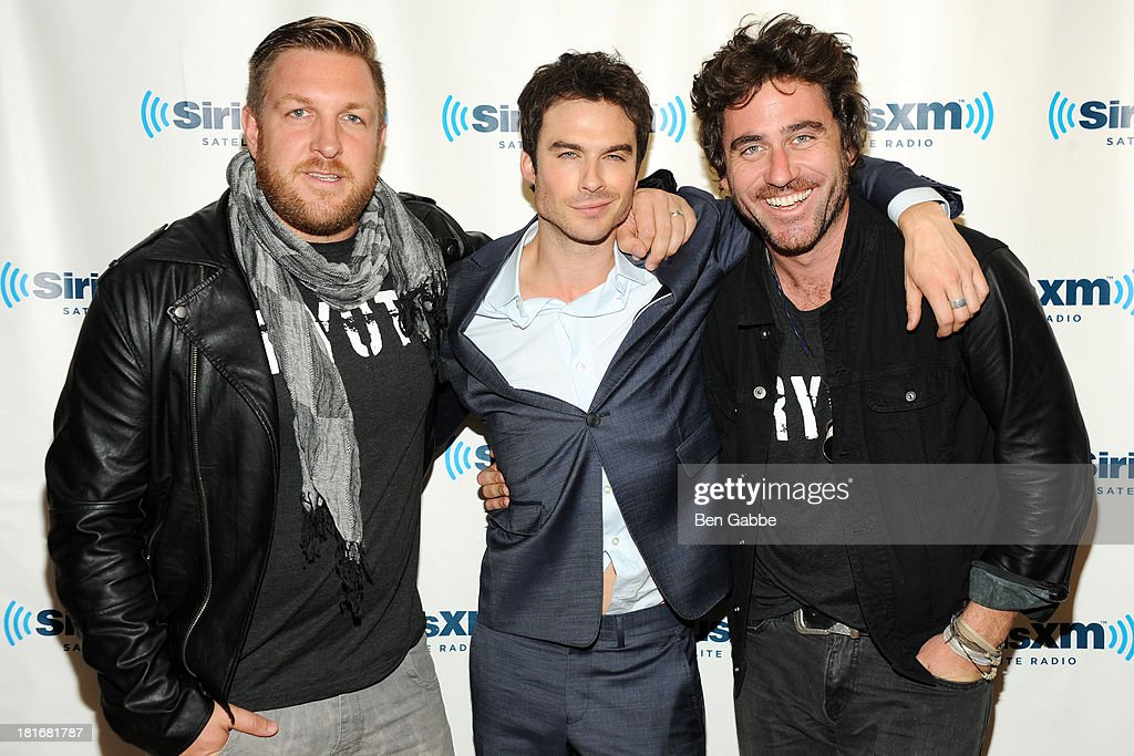 David Darg, <a gi-track='captionPersonalityLinkClicked' href=/galleries/search?phrase=Ian+Somerhalder&family=editorial&specificpeople=614226 ng-click='$event.stopPropagation()'>Ian Somerhalder</a> and Bryn Mooser pose at SiriusXM Studios on September 23, 2013 in New York City.