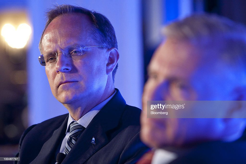 David 'Dave' Barger, president and chief executive officer of JetBlue Airways Corp., left, and Joel Peterson, chairman of the board with JetBlue Airways, listen to a question during the Compliance Week annual conference in Washington, D.C., U.S., on Monday, May 24, 2010. American Airlines will use an agreement with JetBlue to expand its foothold in New York, the world'slargest travel market, and counter growth by Delta Air Lines. Photographer: Andrew Harrer/Bloomberg via Getty Images