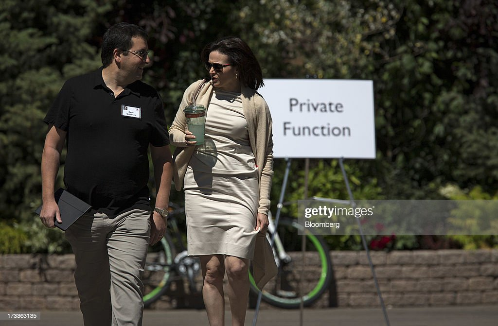 David 'Dave' Goldberg, chief executive officer of SurveyMonkey, left, walks with Sheryl Sandberg, chief operating officer of Facebook Inc., after a session at the Allen & Co. Media and Technology Conference in Sun Valley, Idaho, U.S., on Friday, July 12, 2013. Executives from media, finance and politics mingle at the mountain resort between presentations on business trends and social issues, brought together by New York investment banker Herb Allen. Photographer: Scott Eells/Bloomberg via Getty Images