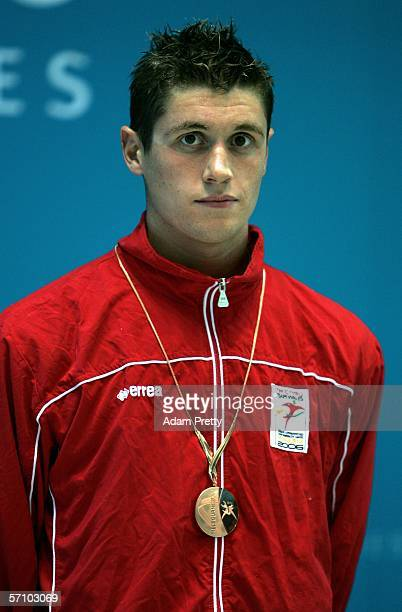 David Davies of Wales looks disappointed after winning the bronze medal the men's 400m freestyle final during the swimming at the Melbourne Sports...