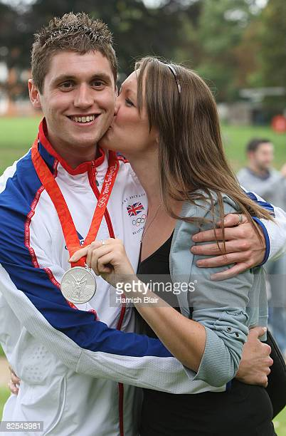 David Davies silver medalist in the Open Water 10km Swim with girlfriend Cari Fflur Davies during a function reuniting members of the Great British...