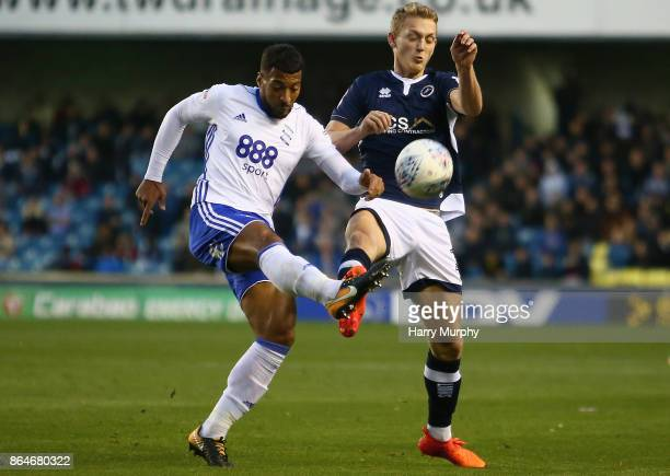David Davis of Birmingham City and George Saville of Millwall battle for possession during the Sky Bet Championship match between Millwall and...