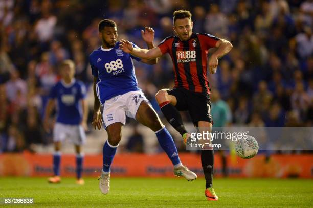 David Davis of Birmingham City and Marc Pugh of AFC Bournemouth battle for possession during the Carabao Cup Second Round match between Birmingham...