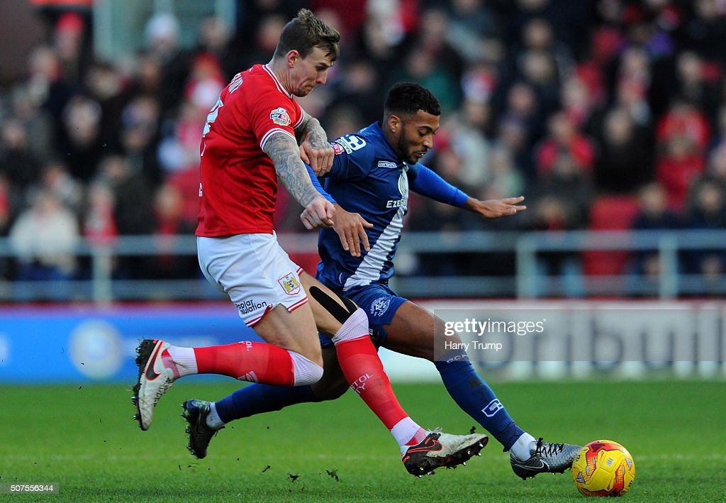 David Davis of Birmingham City is tackled by Aden Flint of Bristol City during the Sky Bet Championship match between Bristol City and Birmingham...