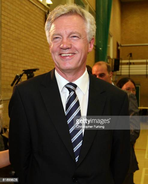 David Davis the former shadow home secretary of the Conservative party prepares for a TV interview as he arrives at the byelection count for the...