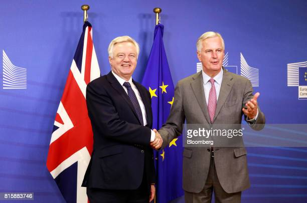 David Davis UK exiting the European Union secretary left and Michel Barnier chief negotiator for the European Union shake hands ahead of Brexit...