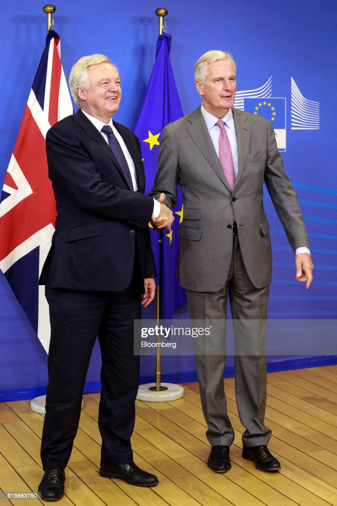 David Davis, U.K. exiting the European Union (EU) secretary, left, and Michel Barnier, chief negotiator for the European Union (EU), shake hands ahead of Brexit negotiations in Brussels, Belgium, on Monday, July 17, 2017. 'Brexit talks made a good start last month, we are now entering into the substance', Davis said ahead of meeting with Barnier. Photographer: Dario Pignatelli/Bloomberg via Getty Images