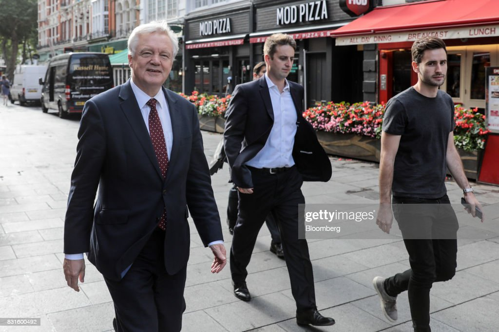 David Davis, U.K. exiting the European Union (EU) secretary, left, walks in-between doing media interviews in London, U.K., on Tuesday, Aug. 15, 2017. The U.K. government said it wants to maintain tariff-free, bureaucracy-light trade with the European Union for a period of up to two years after Brexit, a proposalcheered by British businesses but which is likely to raise eyebrows on the continent. Photographer: Simon Dawson/Bloomberg via Getty Images