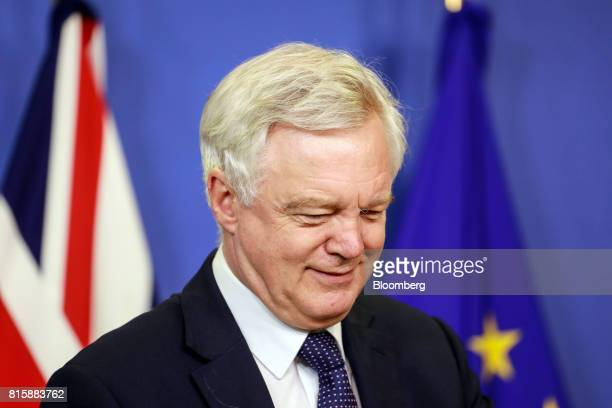 David Davis UK exiting the European Union secretary reacts as he arrives ahead of Brexit negotiations in Brussels Belgium on Monday July 17 2017...
