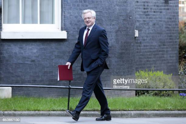 David Davis UK exiting the European Union secretary walks in Downing Street in London UK on Monday March 13 2017 The House of Commons is set to vote...