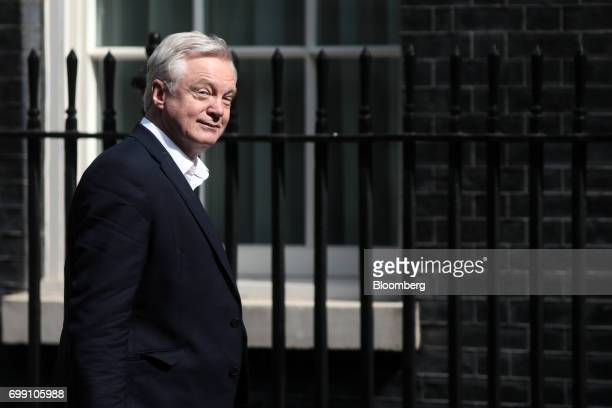 David Davis UK exiting the European Union secretary walks in Downing Street to attend the state opening of Parliamentin London UK on Wednesday June...
