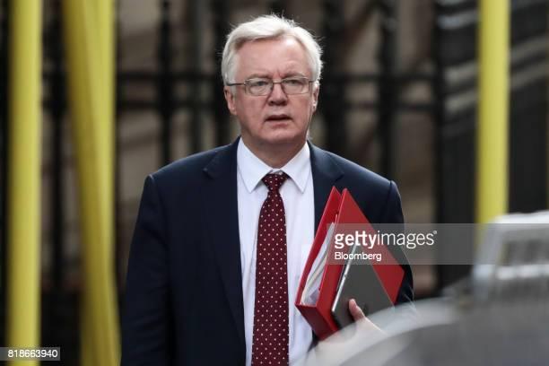 David Davis UK exiting the European Union secretary walks in Downing Street in London UK on Wednesday July 19 2017 UK Prime MinisterTheresa Maywill...