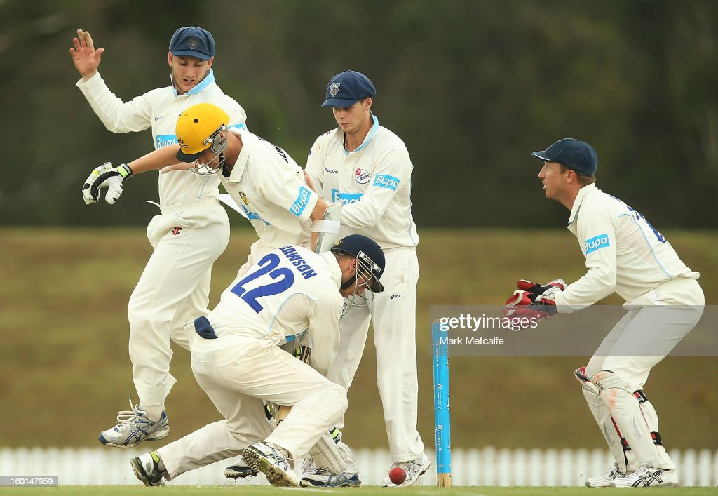 David Dawson and Steven Smith of the Blues collide with Jason Behrendorff of the Warriors during day four of the Sheffield Shield match between the New South Wales Blues and the Western Australia Warriors at Bankstown Oval on January 27, 2013 in Sydney, Australia.