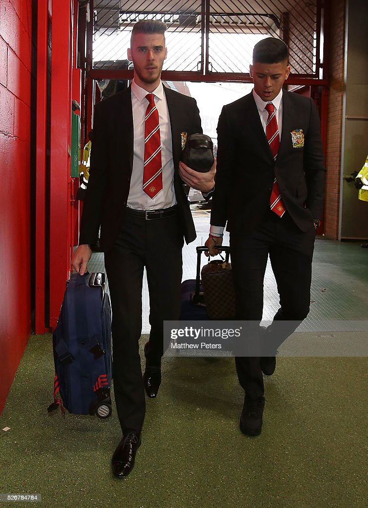<a gi-track='captionPersonalityLinkClicked' href=/galleries/search?phrase=David+de+Gea&family=editorial&specificpeople=3000749 ng-click='$event.stopPropagation()'>David de Gea</a> and <a gi-track='captionPersonalityLinkClicked' href=/galleries/search?phrase=Marcos+Rojo&family=editorial&specificpeople=6740047 ng-click='$event.stopPropagation()'>Marcos Rojo</a> of Manchester United arrives at Old Trafford ahead of the Barclays Premier League match between Manchester United and Leicester City at Old Trafford on May 1, 2016 in Manchester, England.