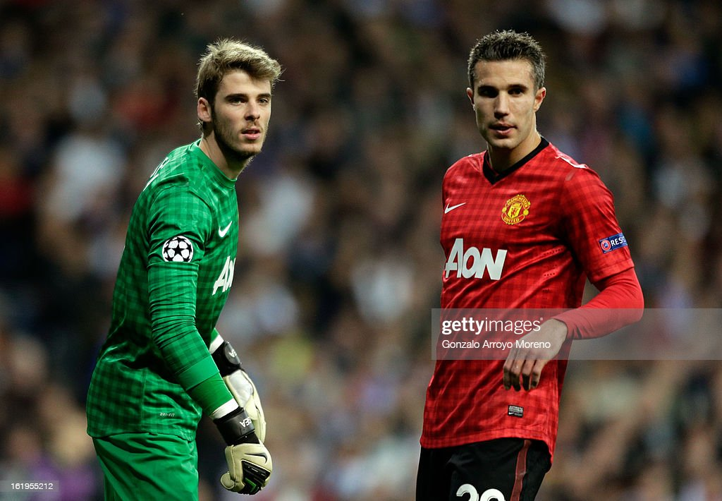 David De Gea and Robin van Persie of Manchester United look on during the UEFA Champions League Round of 16 first leg match between Real Madrid and Manchester United at Estadio Santiago Bernabeu on February 13, 2013 in Madrid, Spain.