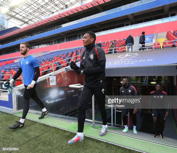 David de Gea Anthony Martial Romelu Lukaku and Axel Tuanzebe of Manchester United walk out ahead of a training session ahead of their UEFA Champions...