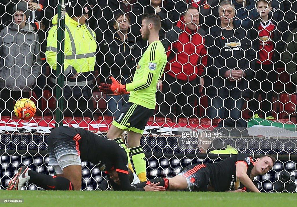 David de Gea, Chris Smalling and Phil Jones of Manchester United react to Marko Arnautovic of Stoke City scoring their second goal during the Barclays Premier League match between Stoke City and Manchester United at Britannia Stadium on December 26, 2015 in Stoke on Trent, England.