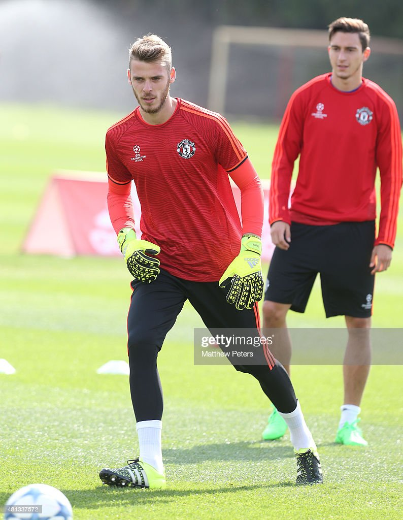 <a gi-track='captionPersonalityLinkClicked' href=/galleries/search?phrase=David+de+Gea&family=editorial&specificpeople=3000749 ng-click='$event.stopPropagation()'>David de Gea</a> in action during a first team training session, ahead of their UEFA Champions League play-off first leg match against Club Brugge, at Aon Training Complex on August 17, 2015 in Manchester, England.