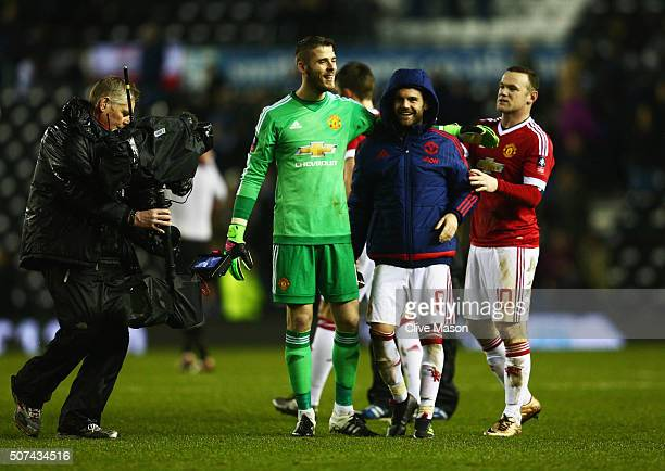 David De Gea Juan Mata and Wayne Rooney of Manchester United celebrate victory after the Emirates FA Cup fourth round match between Derby County and...