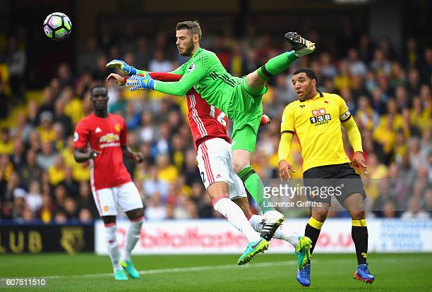 David De Gea of Manchester United attempts to collect the ball from a cross but colides with Chris Smalling of Manchester United during the Premier...